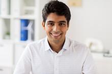 Smiling Indian Businessman At ...