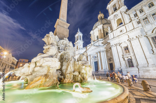 Fotografie, Obraz  Navona Square with tourists at night, Italy
