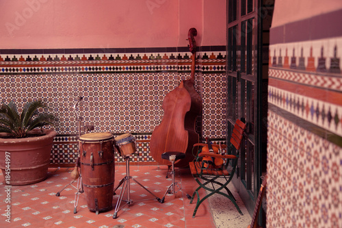Poster Havana Musical Instruments in the background of a decorative wall, streets of Havana, Cuba