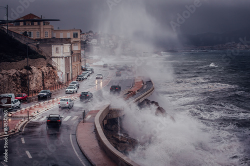 Keuken foto achterwand Onweer Scary Stormy background with Big Sea Wave Splash Against City Road