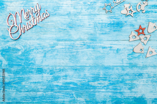 Merry Christmas sign, view from top, above, flat, on painted, blue wooden background, Xmas greeting card, with space for text wish