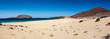 Wild beach Las Conchas in Lanzarote. Canary islands.White sand and blue sea.