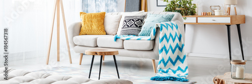 Sofa with blue patterned blanket Canvas Print
