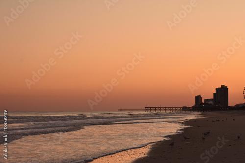 Spoed Foto op Canvas Zee zonsondergang Sunset on the beach at Myrtle Beach South Carolina