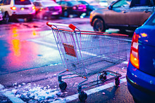 Supermarket Cart On Night Car Parking