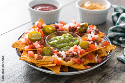 Cuadros en Lienzo Mexican nachos with beef, guacamole, cheese sauce, peppers, tomato and onion in