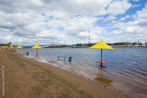 City on the water View of the flooded city beach in the center of Veliky Novgorod in the cloudy April afternoon. Russia
