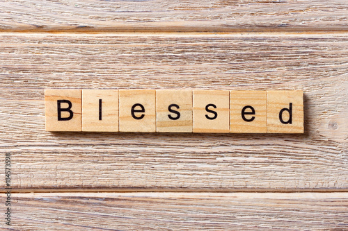 Blessed word written on wood block Canvas Print