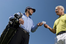 Golfer Giving His Card To The ...