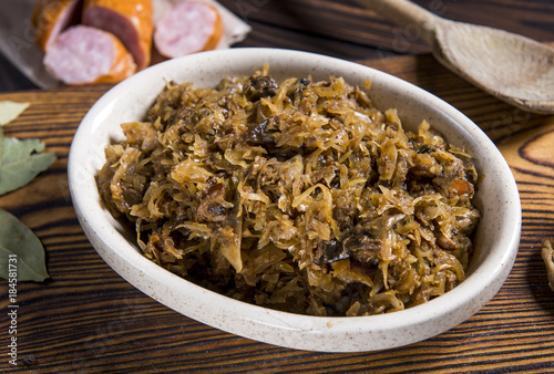 Cabbage stew with meat, mushrooms and dried plums - traditional polish dish
