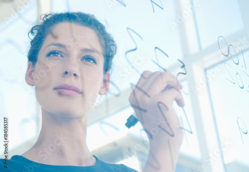 Woman writes on glass Canvas Print