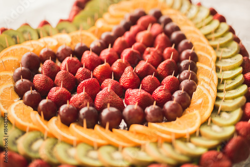 Authentic buffet, assorted fresh fruits, berries and citrus. Preparation for design creative menu