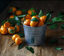 Tangerines In A Bucket On Wood...