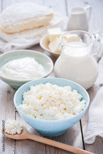Papiers peints Produit laitier Organic Farming Cottage cheese in a blue bowl, sour cream, butter, cheese and milk