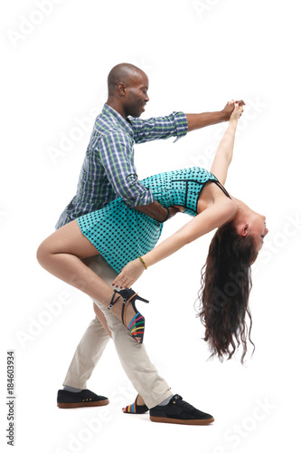 Black man and caucasian woman in casual clothes in incendiary dance isolated on white background Wallpaper Mural