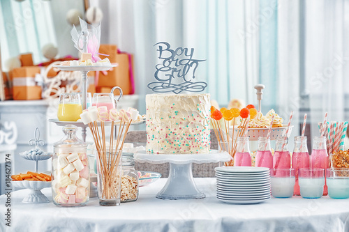 """""""Boy or girl"""" cake and different treats for baby shower party on table indoors Canvas Print"""