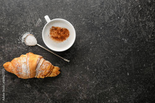 Fotografie, Obraz  Composition with tasty croissant and coffee on dark background