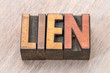 lien word abstract in wood type