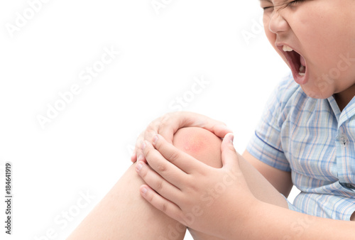 Fotografía  Obese fat boy suffering from knee pain