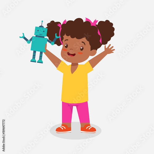 Fototapeta african american little girl playing with robot obraz