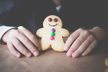Boy Holding A Gingerbread Man Cookie