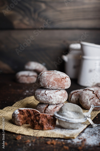 Fényképezés  Deliciouse Homemade Chocolate crinkle cookies with powdered sugar icing on dark stone table background