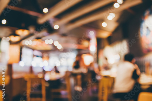 Fotobehang Restaurant Restaurant cafe or coffee shop interior with people abstract blur background