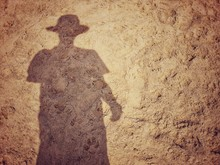 Shadow Of A Men On Sand Beach Background With Place Your Text/ Abstract Image