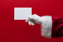 Santa Claus Hand Holding A Blank White Sign