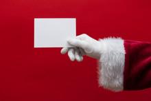 Santa Claus Hand Holding A Bla...
