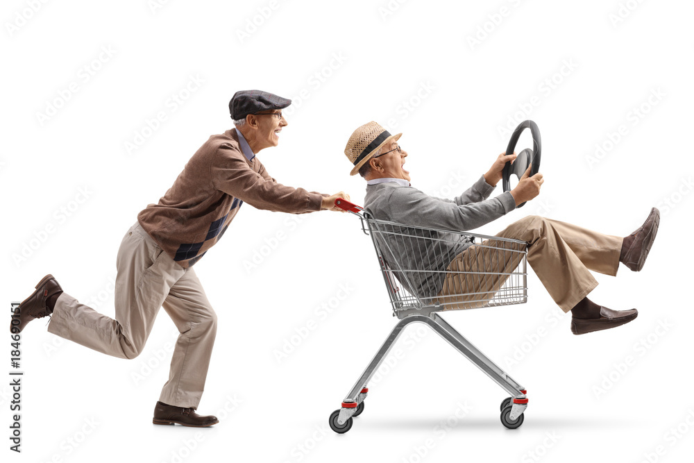 Fototapety, obrazy: Senior pushing a shopping cart with another senior with a steering wheel riding inside