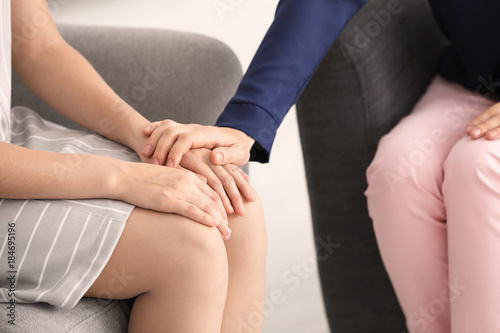 Valokuvatapetti Female psychologist calming her patient in office