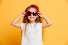 Little Cute Smiling Girl Wearing Sunglasses Looking Camera.