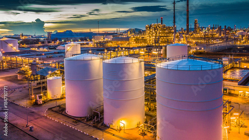 Foto Aerial view oil terminal is industrial facility for storage tank of oil and petrochemical industry products ready for transport to further storage facilities