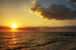 Beautiful blazing sunset landscape at Gulf of Mexico. Beauty of colorful sky sunset. Awesome sun golden reflection on calm waves as a background. Amazing summer sunset view on the beach.