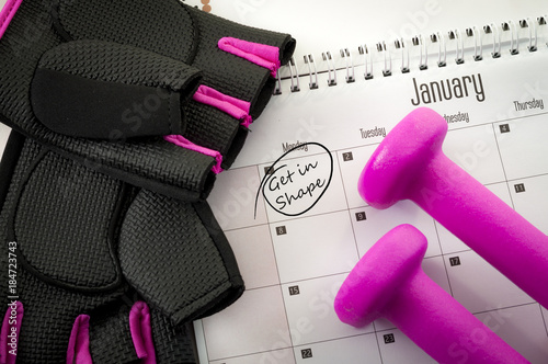 Fotografie, Obraz  New year resolution and the desire to get in shape concept with a calendar with