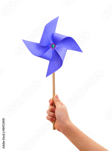 Kid hand holding a blue pinwheel close up isolated on white background Tapéta, Fotótapéta