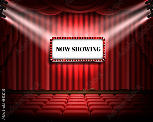 Red Curtain And Empty Illuminated Theatrical Stage With White Luminous Banner Text Now Showing