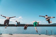 5 Guys Jumping In Lake In A Fl...