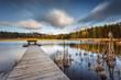 Small woody fishing pier at the lake.