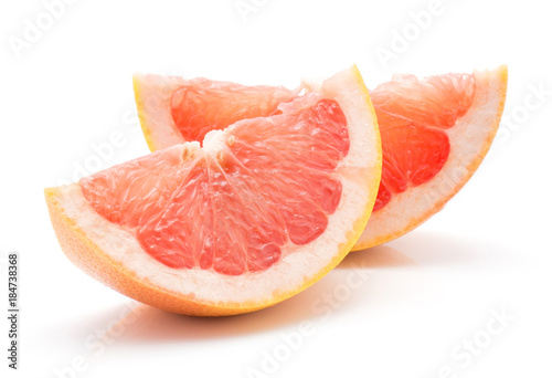 Carta da parati Two red grapefruit slices isolated on white background.