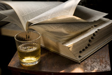 Whisky Glass And A Tumbling Book