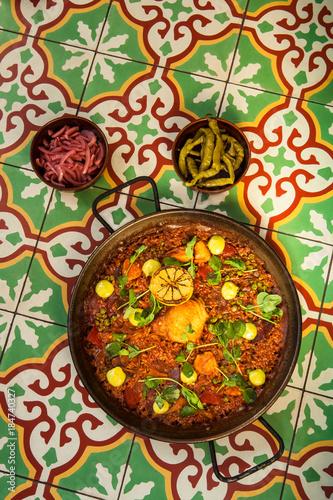 Fotografie, Obraz  chorizo and pollo paella on tile tabletop