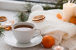Winter breakfast. Tangerine and a cup of tea. Tree and the candles on the windowsill. Christmas morning