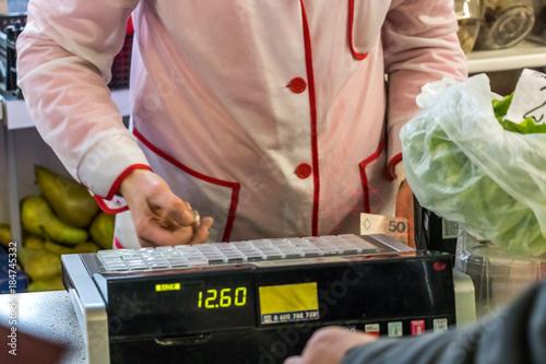 vintage seller, sales assistant on a cash register Fototapeta