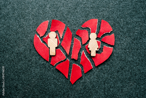 Paper Red Broken Heart With Wooden Figures Of Man And Woman On Dark