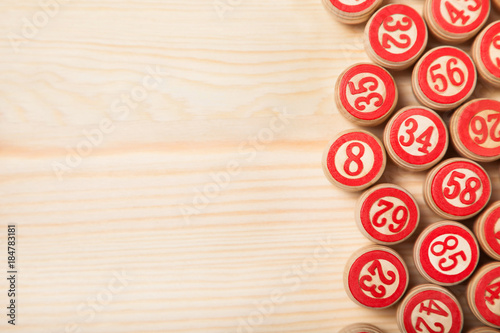 Photo Bingo lotto on wooden background with copy space
