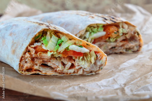Photo  Roll with chicken and vegetables. Shawarma. Fast food.