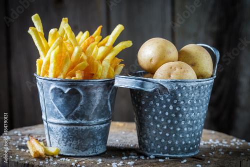 Cuadros en Lienzo Closeup of french fries with salt made of fresh potato