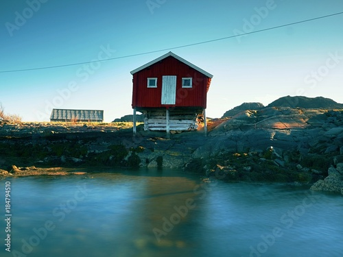 Photo  Traditional red and white houses in small fishing village